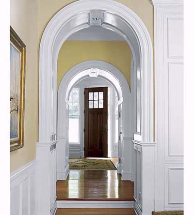 arched moldings framing door