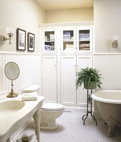 Storage cupboard in vintage-style bathroom