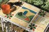 small outdoor table with top made of vintage tile