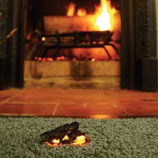 fireplace ember on carpet