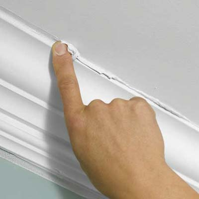 use your finger to smooth out the seams where the molding meets the wall and the ceiling