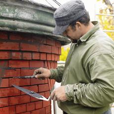 Danny Palousek repointing brick
