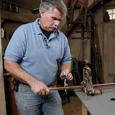 Man creating pot rack