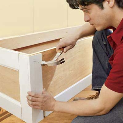attaching the panel molding to the mudroom bench