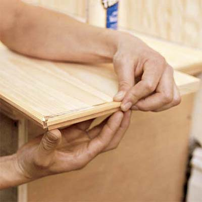 attaching the trim to the mudroom bench seat lid