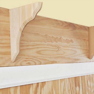 mounting the shelf brackets on the mudroom bench