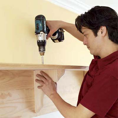 securing the shelf brackets on the mudroom bench