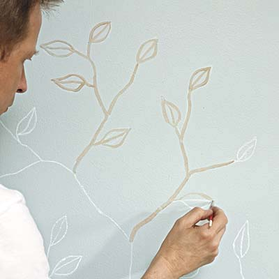 paint applied to chalk sketch of leaves and branches
