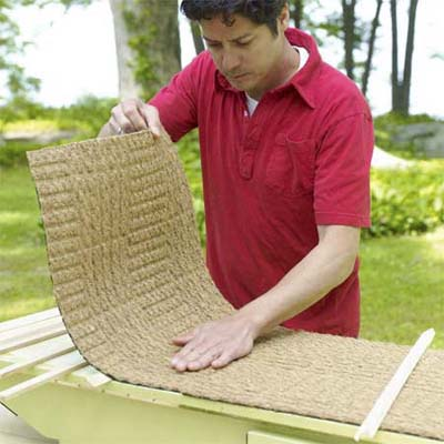 man attaching a non slip rug to the lid of the pet ramp