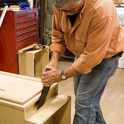Tom Silva removing a toekick from a stock cabinet