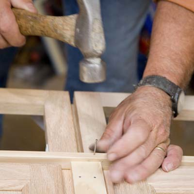 Tom Silva attaching a lattice strip to the joined cabinets