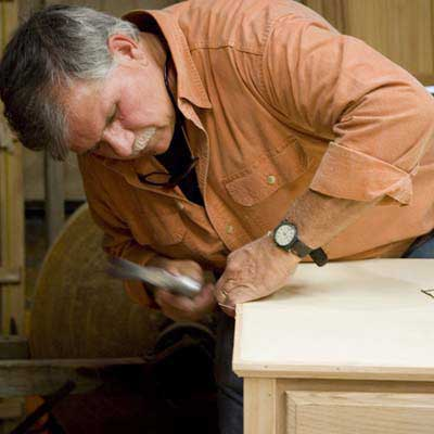 Tom Silva adding the trim to the top of the sideboard