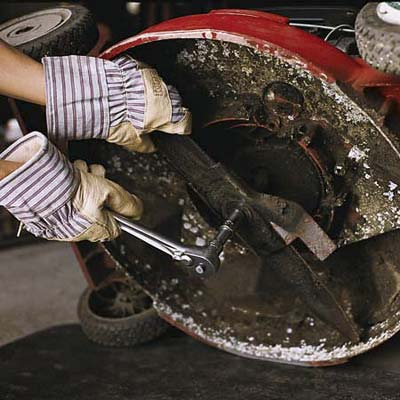 Removing the blade with thick gloves on, and  a socket wrench