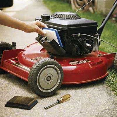 Change the air filter and clear the cooling fins of your lawn mower