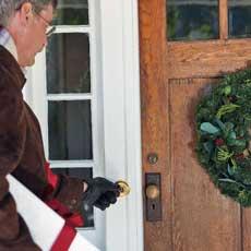 man approaching front door to ring the doorbell