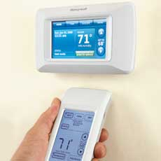 a programmable thermostat with a hand-held remote