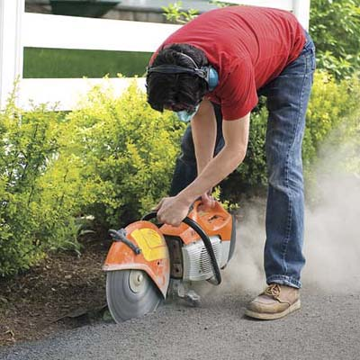 Mark Powers saws into a concrete driveway