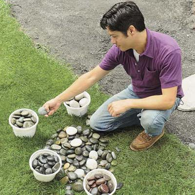 Mark Powers sorting stones in buckets
