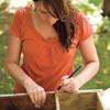 woman measuring window box frame