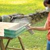 woman sealing window box finish