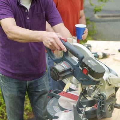 Man cutting jig pieces
