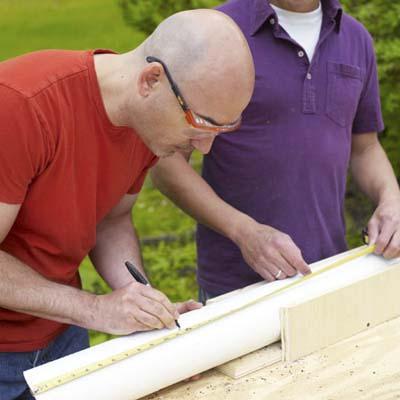 Man marking a straight cut