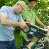 men using miter saw to cut kubb pieces