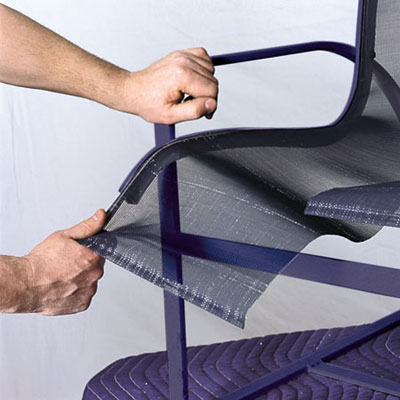 man removing old chair sling off of frame