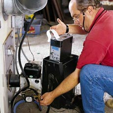 man testing efficiency of furnace