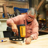 Tom Silva attaches the nailing strips to the top of the shelving unit