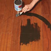 hand painting medallion design on wood floor