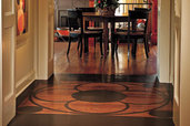 wood floor with painted framed medallion in hallway