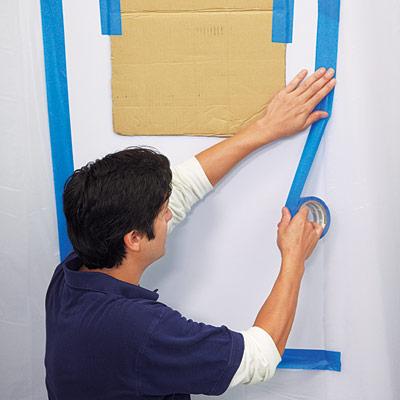 man prepping foyer for wall niche installation
