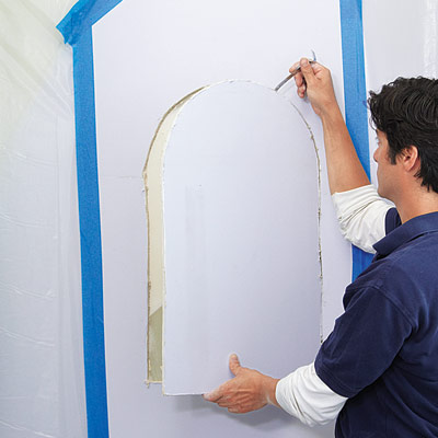 man removing wall cut out for wall niche installation