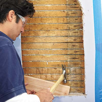 man positioning the blocking for wall niche installation