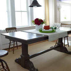 a finished trestle table in a dining area