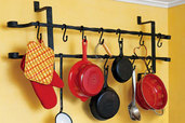 a pot rack that is made from a vintage window guard