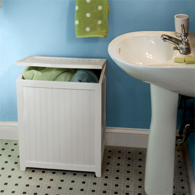 wood hamper in a blue bathroom