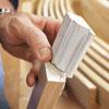 hand tracing profile of custom molding to make duplicate