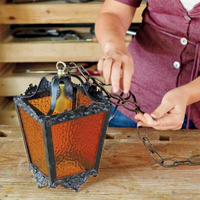 thread the cord and ground wire through the chain to rewire an all-weather lantern