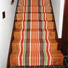 stairs with a colorful stair runner installed