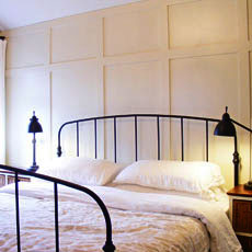 a bedroom with newly installed wood paneling