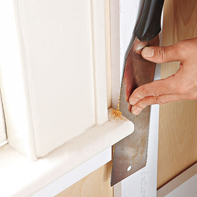 using a Japanese pull-saw to cut existing trim