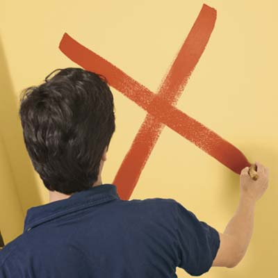 to paint a color wash step two: paint a large x on the wall