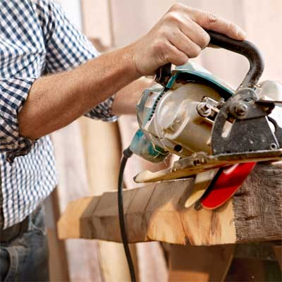cut the beams to build a table from salvage beams