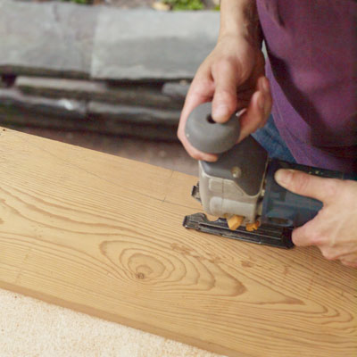 cutting the armrests of a Westport chair with a jigsaw