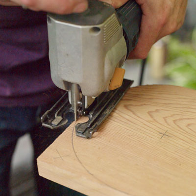 cutting away the rounded part of the armrests of a Westport chair with a jigsaw