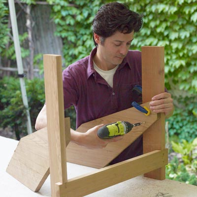 fastening the back legs of a Westport chair with a drill/driver