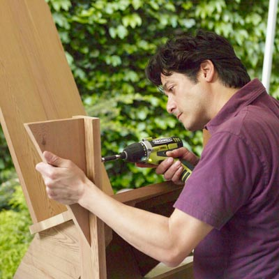 attaching the arm brackets to a Westport chair with a drill/driver