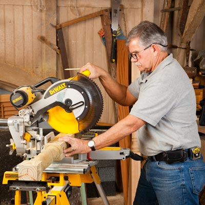 Tom Silva cutting a deck post with a power miter saw